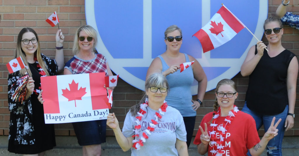ZucoraHome staff posing in front of the office on Canada Day