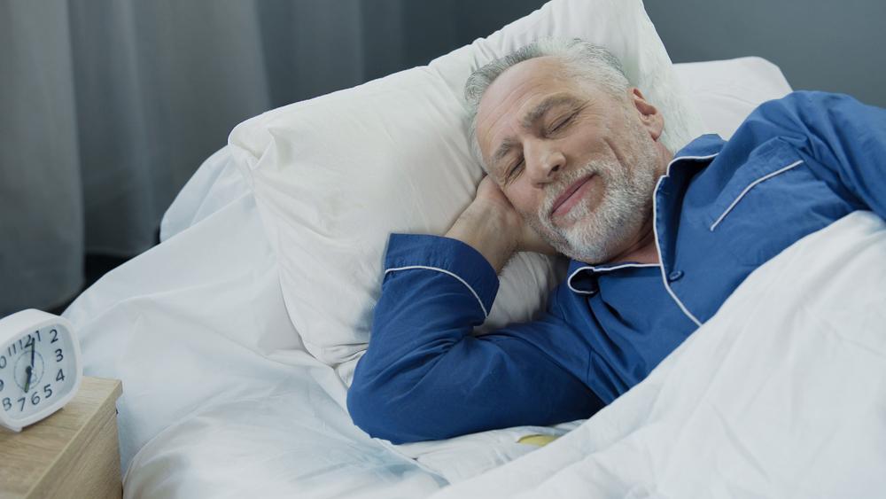 Elderly man smiling in his sleep